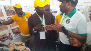 Hon. Minister of Agriculture at SAA's stand discussing with the Country Director Dr. Sani Miko