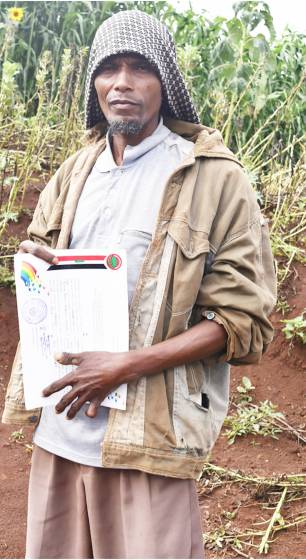 Exemplary Farmer Bashir Lema with certifi cate of recognition awarded to him by the local administration