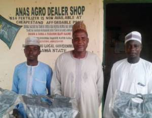 Alhaji Abdu Gana (center), chairman of the Kafin Gana Farmers' Cooperative.