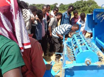 Furi Hirpo showcases one of his multi-crop threshers to a group of smallholder farmers in the Oromia Region of Ethiopia
