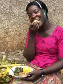 A lady enjoying vitamin A sweet potato and vegetables in Bugiri District, Uganda